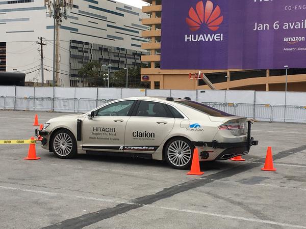 歌乐、日立联合展示远程遥控自动泊车技术